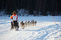 Kevin Harper, on his way to a first-place finish, runs on the inbound trail towards the finish line of the 2016 Junior Iditarod in Willow, Alaska on February 28, 2016<br /> <br /> (C) Jeff Schultz/SchultzPhoto.com ALL RIGHTS RESERVED