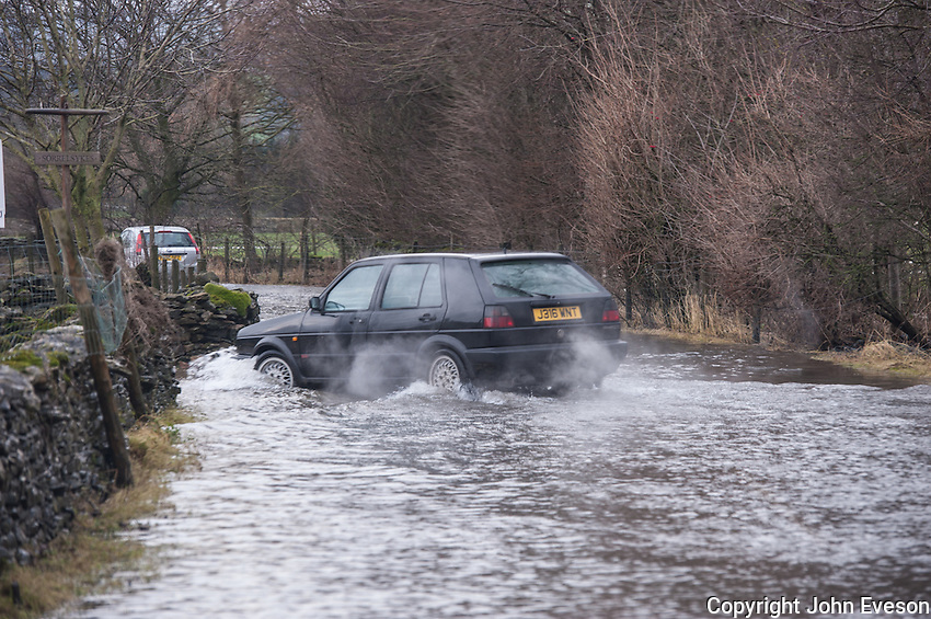Cars in flood water, West Burton, North Yorkshire.