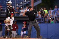 Umpire Donnie Smith ejects Mahoning Valley Scrappers manager Travis Fryman (not shown) for arguing a call as catcher Korey Dunbar looks on during a game against the Batavia Muckdogs on June 24, 2015 at Dwyer Stadium in Batavia, New York.  Batavia defeated Mahoning Valley 1-0 as three Muckdogs pitchers combined to throw a perfect game.  (Mike Janes/Four Seam Images)