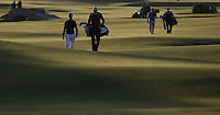 Late evening sunshine across the undulations on the 18th with Victor Riu (FRA) walking in during the practice round before the 2014 Alfred Dunhill Links Championship, The Old Course, St Andrews, Fife, Scotland. Picture:  David Lloyd / www.golffile.ie