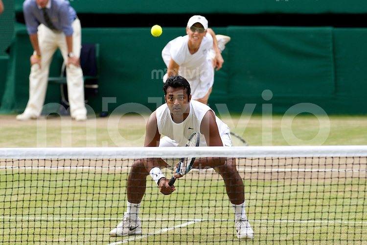 The Final of the Mixed Doubles Leander Paes (IND) and Cara Black (ZIM) plays against Wesley Moodie (RSA) and Lisa Raymond (USA)  on Centre Court. The Wimbledon Championships 2010 The All England Lawn Tennis & Croquet Club  Day 13 Sunday 04/07/2010