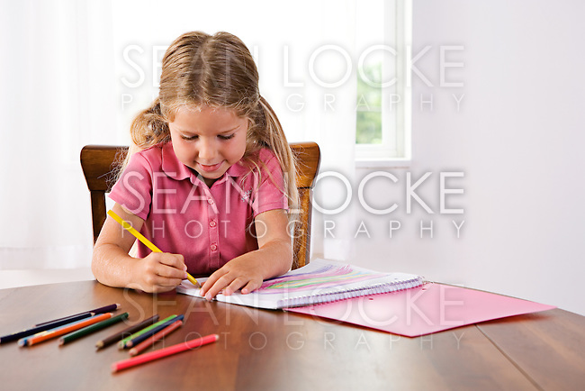 Little girl with school supplies, doing homework, etc.