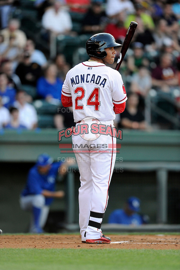 Second baseman Yoan Moncada of the Greenville Drive bats in the second game of his pro career against the Lexington Legends on Tuesday, May 19, 2015, at Fluor Field at the West End in Greenville, South Carolina. The Cuban-born 19-year-old Red Sox signee has been ranked the No. 1 international prospect in baseball by Baseball America. (Tom Priddy/Four Seam Images)