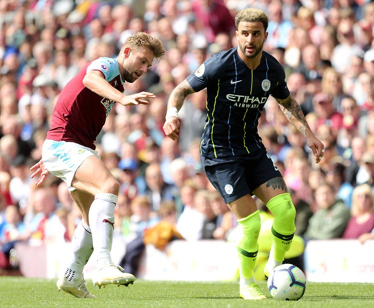 Manchester City's Kyle Walker under pressure from Burnley's Charlie Taylor<br /> <br /> Photographer Rich Linley/CameraSport<br /> <br /> The Premier League - Burnley v Manchester City - Sunday 28th April 2019 - Turf Moor - Burnley<br /> <br /> World Copyright © 2019 CameraSport. All rights reserved. 43 Linden Ave. Countesthorpe. Leicester. England. LE8 5PG - Tel: +44 (0) 116 277 4147 - admin@camerasport.com - www.camerasport.com