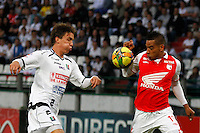 MANIZALES -COLOMBIA - 05-05-2013: Wilder Medina del Independiente Santa Fe, disputa el balón con David Alvarez, durante partido en la fecha 14 de la Liga Postobón, en el estadio Palogrande de la ciudad de Manizales, el 05 de mayo de 2013. Wilder Medina of Independiente Santa Fe, fights for the ball with David Alvarez of Once Caldas, during match on the date 14 of the League Postobón Palogrande stadium in Manizales. (Photo: VizzorImage / Yonboni / Str).