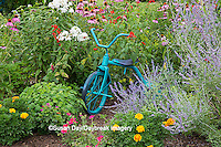 63821-23011 Old blue tricycle in flower garden, Marion Co., IL