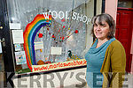 Marie Mc Carthy standing outside her Wool Shop window displaying her Lockdowntree project as a fundraiser for the Kerry Hospice Foundation.