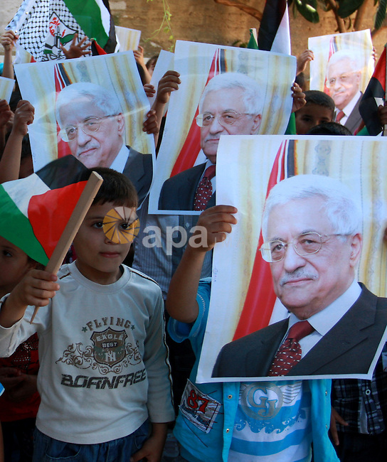 Palestinian children hold posters, in support with the Palestinian President Mahmoud Abbas, during a rally in  the village of Azmut in the West Bank city of Nablus, on Sept. 18, 2011. Palestinian President Mahmoud Abbas is set to address the U.N. next week, planning to ask the world to recognize a Palestinian state. Number 194 represents the Palestinian hope to become 194th member of the UN. Photo by Wagdi Eshtayah