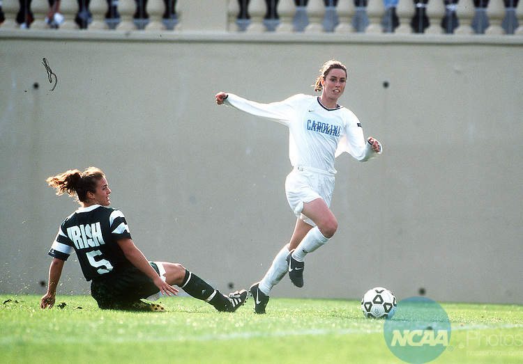 5 DEC 1999: University of North Carolina forward Raven McDonald (18) looks for a pass while Notre Dame midfielder Vanessa Pruzinsky attempts a steal during the Division 1 Women's Soccer Championship held at Spartan Stadium in San Jose, CA. North Carolina defeated Notre Dame 2-0 for the championship title. Jose Villegas/NCAA Photos.