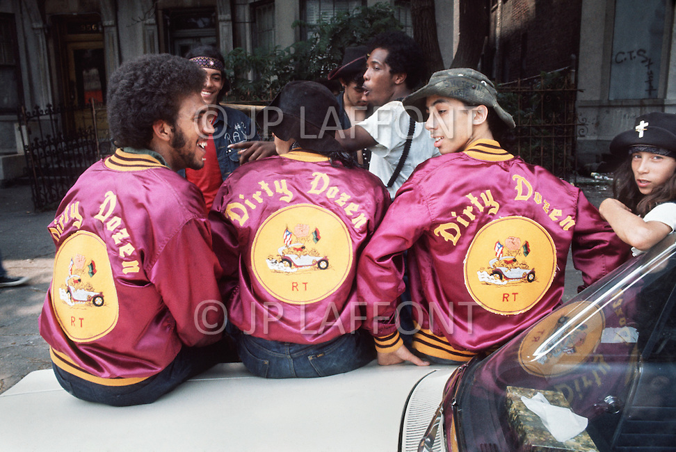 "New York, NY July 1972 - New York street gang ""Savage Skulls"". The trademark of the primarily Puerto Rican gang was a sleeveless denim jacket with a skull and crossbones design on the back. Based in the Hunts Point area of the  South Bronx, the gang declared war on the drug dealers that operated in the area. Running battles were frequent with rival gangs ""Seven Immortals"" and ""Savage Nomads"".  - members of the ""Dirty Dozen"" gang"