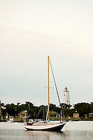 Sailing ships (sailboats) and fishing docks in Silver Lake Harbor off Pamlico Sound make an attractive and romantic foreground to the Ocracoke Lighthouse. Ocracoke Light remains among the oldest lighthouses still active on the southern coast of North Carolina's Outer Banks, and it is the second oldest operating lighthouse in the United States (the first is Sandy Hook Light house in New Jersey). The first Ocracoke Lighthouse was built in 1803 on Shell Castle Island inside the Ocracoke Inlet not far from Blackbeard's hideout. Destroyed by lightning in 1818 it was replaced by the current light in 1823 on the banks of the inlet near Ocracoke Village. The white-brick conical lighthouse stands 75 feet tall and has 220 stairs to its top, though visitors are not allowed to climb. Ocracoke Island can only be reached by ferry. Charlotte NC photographer Patrick Schneider has extensive photo collections of the following lighthouses: Bodie Island Lighthouse, Bald Head Island Lighthouse, Cape Fear Lighthouse, Cape Hatteras Lighthouse, Cape Lookout Lighthouse, Currituck Beach Lighthouse, Diamond Shoal Lighthouse, Federal Point Lighthouse, Oak Island Lighthouse, and Ocracoke Lighthouse on Ocracoke Island.