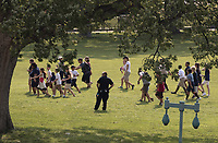 Tourists are directed away from the Capitol Building and across the lawn by Capitol Hill Police officers, Wednesday, June 14, 2017, after House Majority Whip Steve Scalise of La. was shot at a Congressional baseball practice in Alexandria, Va.  (AP Photo/J. Scott Applewhite)