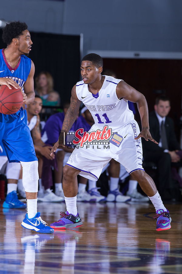 Haiishen McIntyre (11) of the High Point Panthers on defense during first half action against the Presbyterian Blue Hose at Millis Athletic Center on February 21, 2015 in High Point, North Carolina.  The Panthers defeated the Blue Hose 67-58.   (Brian Westerholt/Sports On Film)