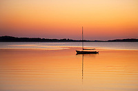 Sailboat at sunset, Cape Cod, Massachusetts, USA.