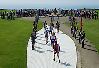 A wreath laying ceremony at the Battle of Britain memorial at Capel-le Ferne, between Dover and Folkeston on the fifth and penultimate day of the charity Help for Heroes Big Battlefield Bike Ride from Paris to London, after an early crossing from Calais. Following the ceremony, in memory of the 3000 men of Fighter Command who represented 'The Few', to the surprise of the participants in the Help for Heroes bike ride, a spitfire flew low over the heads of the cyclists and circled the memorial. Later in the day the bike ride continued to Chatham Naval Memorial where a second wreath laying ceremony took place. Saturday 1st June 2013.