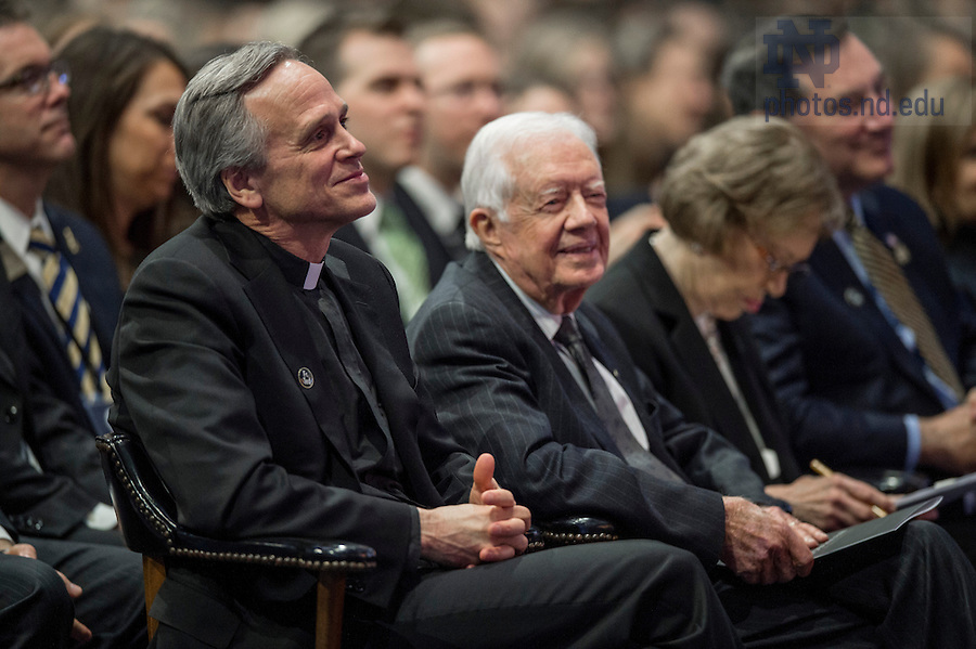 Mar. 4, 2015; University President Rev. John Jenkins, C.S.C., and former President of the United States, Jimmy Carter, listen to a speaker during the tribute ceremony in the Purcell Pavilion to honor the life of the late President Emeritus Rev. Theodore M. Hesburgh, C.S.C. (Photo by Barbara Johnston/University of Notre Dame)