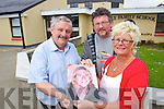 """Teacher Sean Lyons with Anne and John Buggy with a photo of their son Adam who died last year. The Holy Family school have named their annual charity walk In honour Adam, who went to school at Holy Family and was one of the first boys to do the walk, it is now """"The Adam Buggy Annual walk""""."""