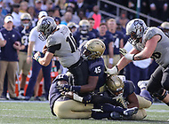 Annapolis, MD - October 21, 2017: Navy Midshipmen linebacker D.J. Palmore (45) tackles UCF Knights quarterback McKenzie Milton (10) during the game between UCF and Navy at  Navy-Marine Corps Memorial Stadium in Annapolis, MD.   (Photo by Elliott Brown/Media Images International)
