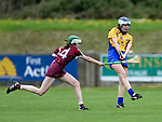 Evelyn Duggan of Clare in action against Elisha Broderick of Galway during their Minor A All-Ireland final at Nenagh.  Photograph by John Kelly.