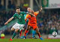 16th November 2019; Windsor Park, Belfast, Antrim County, Northern Ireland; European Championships 2020 Qualifier, Northern Ireland versus Netherlands; Stuart Dallas of Northern Ireland and Ryan Babel of Netherlands challenge for the ball - Editorial Use