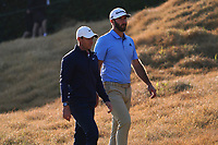 Dustin Johnson (USA) & Rory McIlroy (NIR) walk on the 18th during the second round of the The Genesis Invitational, Riviera Country Club, Pacific Palisades, Los Angeles, USA. 13/02/2020<br /> Picture: Golffile | Phil Inglis<br /> <br /> <br /> All photo usage must carry mandatory copyright credit (© Golffile | Phil Inglis)