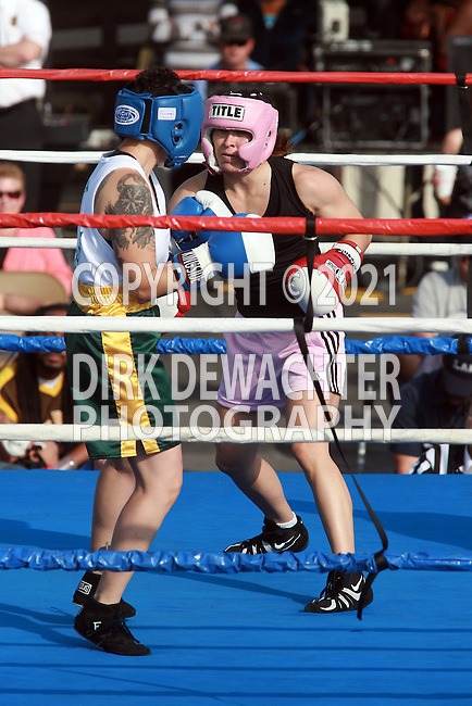 "Whittier, CA 05/10/08 - Evette Almarez of the Los Angeles County Fire Department (in black shirt and pink trunks) boxes against Los Angeles County Sheriff's Department's Mary ""Speedy"" Vasquez during the LASD boxing event held at the Los Angeles County Sheriff's Academy in Whittier."