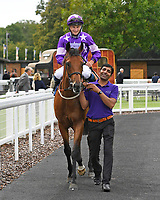 Winner of The Booker Wholesale Handicap Div 2 Cuttin' Edge ridden by Tom Marquand and trained by William Muir is led into the Winner's enclosure during Horse Racing at Salisbury Racecourse on 15th August 2019