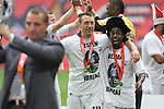 Swansea players Stephen Dobbie and Nathan Dyer celebrate as manager Brendan Rodgers shows off the winners' trophy after the Npower Championship play-off final between Reading (blue) and Swansea City at Wembley Stadium. The match was won by Swansea by 4 goals to 2 watched by a crowd of 86,581. Swansea became the first Welsh team to reach the top division of English football since they themselves played there in 1983.