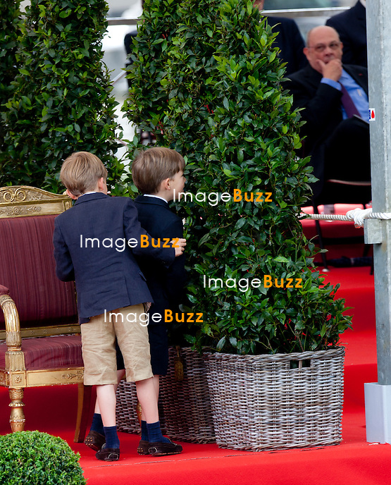 Prince Nicolas and Prince Aymeric, twin sons of Princess Claire of Belgium, Prince Laurent of Belgium pictured during a military parade on the occasion of today's Belgian National Day, Saturday 21 July 2012 in Brussels.