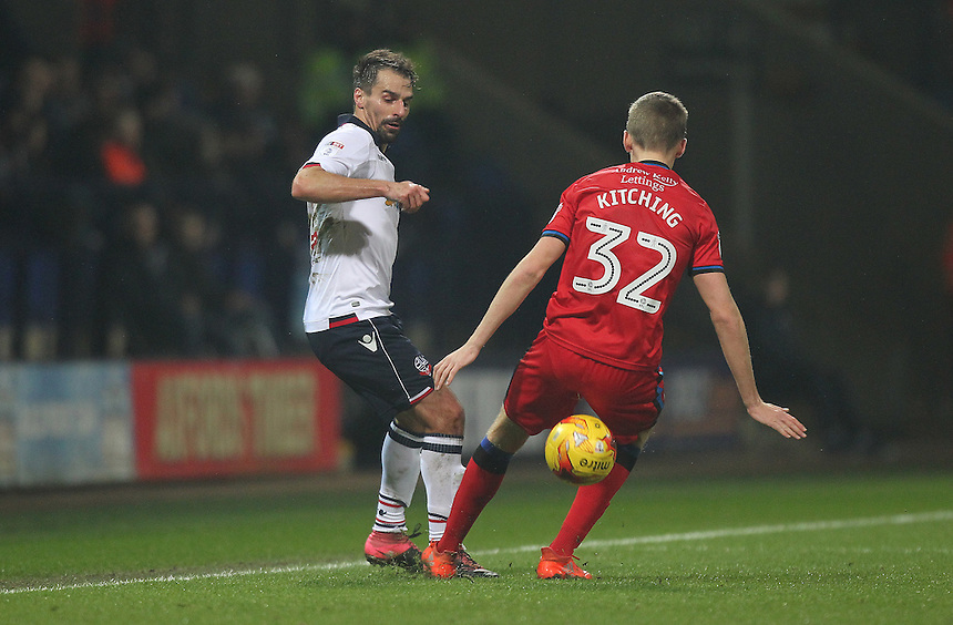 Bolton Wanderers Filipe Moraisnut megs Rochdale's Mark Kitching<br /> <br /> Photographer Mick Walker/CameraSport<br /> <br /> The EFL Sky Bet League One - Bolton Wanderers v Rochdale - Tuesday 14th February 2017 - Macron Stadium - Bolton<br /> <br /> World Copyright &copy; 2017 CameraSport. All rights reserved. 43 Linden Ave. Countesthorpe. Leicester. England. LE8 5PG - Tel: +44 (0) 116 277 4147 - admin@camerasport.com - www.camerasport.com