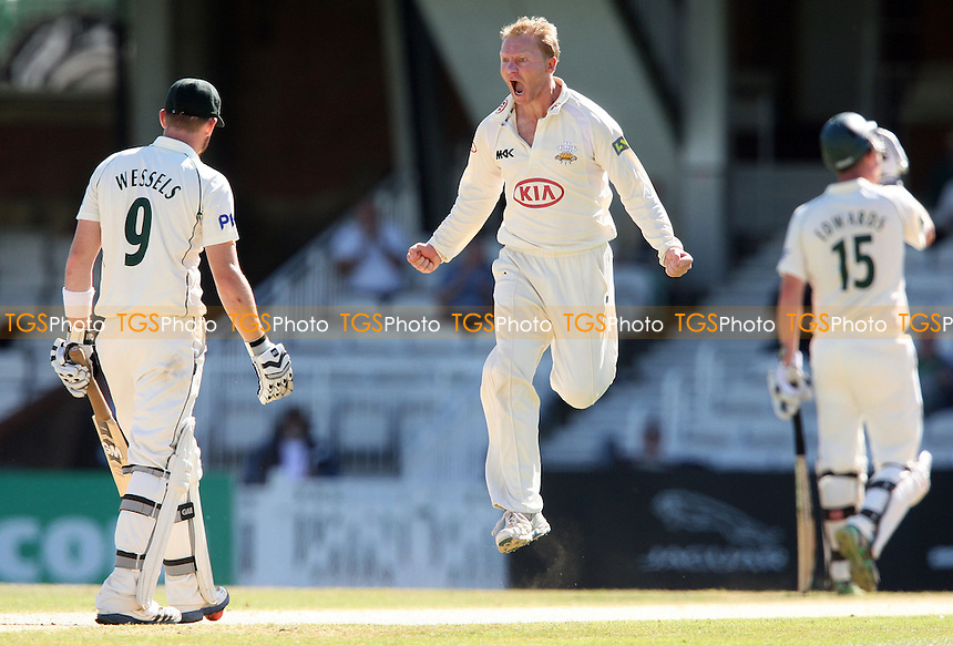 Surrey bowler Gareth Batty celebrates after claiming the wicket of Notts batsman Riki Wessels - Surrey CCC vs Nottinghamshire CCC, LV County Championship Division 1 at The Kia Oval, Kennington - 07/09/12 - MANDATORY CREDIT: Rob Newell/TGSPHOTO - Self billing applies where appropriate - 0845 094 6026 - contact@tgsphoto.co.uk - NO UNPAID USE.