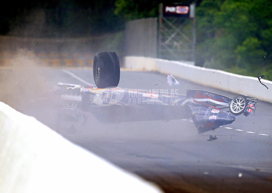 May 5, 2017; Commerce, GA, USA; NHRA super comp driver Jimmy Stahl flips over as he crashes after losing a wheel during qualifying for the Southern Nationals at Atlanta Dragway. Stahl was alert and transported to a local hospital for observation. Mandatory Credit: Mark J. Rebilas-USA TODAY Sports