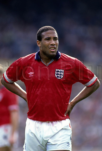 25 May 1991: England player John Barnes stands with hands on hips during England's drawn International match against Argentina at Wembley, England 2 v Argentina 2. Photo: Chris Barry/actionplus...910525.soccer black player