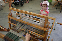 Emma Veenstra, 3, watches Kathy Sano weave. Veenstra is from Holland, Mich, and was visting her grandparents. NW Washington Fair. August 20, 2009 PHOTOS BY MERYL SCHENKER            .