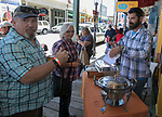Dave Nair, right, serves samples during the Taste of the Comstock in Virginia City on Saturday, June 10, 2017.