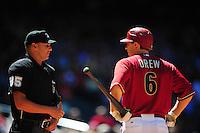 Apr. 27, 2011; Phoenix, AZ, USA; Arizona Diamondbacks shortstop Stephen Drew argues with umpire Vic Carapazza against the Philadelphia Phillies at Chase Field. Mandatory Credit: Mark J. Rebilas-