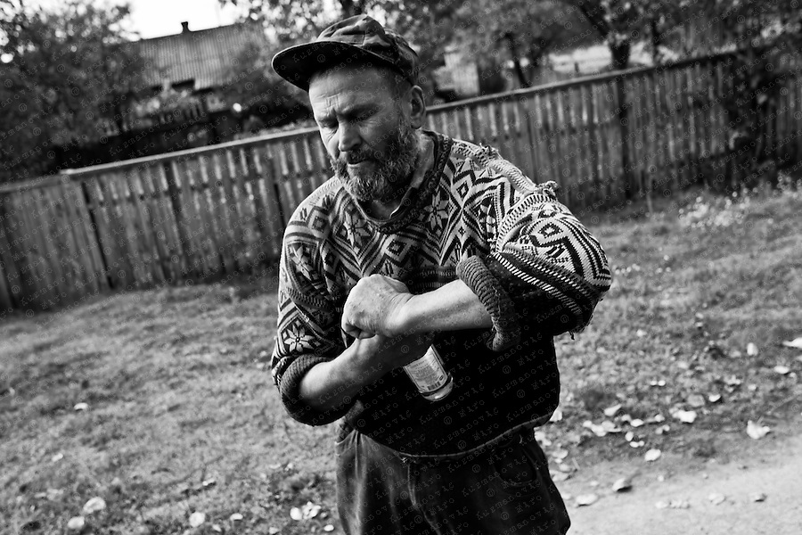Ivan drinks a bottle of vodka, a half-deserted village near Chernobyl.Alcohol has always had a special place in Slavic society, where vodka translates literally as ?little water? and where binge-drinking is an accepted norm even among young teenagers.