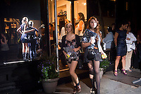 Shoppers outside the Cynthia Rowley boutique on Bleecker Street in the West Village in New York on Friday, September 10, 2010 during the second annual Fashion's Night Out event. On the first evening of New York Fashion Week stores around the city offered sales and bargains as well as parties and events to entice customers to shop. The event has been so successful in boosting sales that this year over 100 cities in the US are having their own events, and Fashion's Night Out is being planned for 16 countries. (© Frances M. Roberts)
