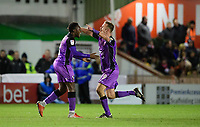 Port Vale's Emmanuel Oyeleke, left, celebrates scoring his side's equalising goal to make the score 1-1 with team-mate Tom Pope<br /> <br /> Photographer Chris Vaughan/CameraSport<br /> <br /> The EFL Sky Bet League Two - Lincoln City v Port Vale - Tuesday 1st January 2019 - Sincil Bank - Lincoln<br /> <br /> World Copyright © 2019 CameraSport. All rights reserved. 43 Linden Ave. Countesthorpe. Leicester. England. LE8 5PG - Tel: +44 (0) 116 277 4147 - admin@camerasport.com - www.camerasport.com