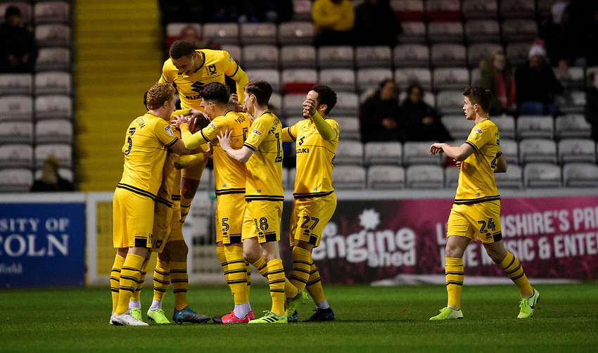 Milton Keynes Dons' Rhys Healey celebrates scoring the opening goal with team-mates<br /> <br /> Photographer Chris Vaughan/CameraSport<br /> <br /> The EFL Sky Bet League One - Lincoln City v Milton Keynes Dons - Tuesday 11th February 2020 - LNER Stadium - Lincoln<br /> <br /> World Copyright © 2020 CameraSport. All rights reserved. 43 Linden Ave. Countesthorpe. Leicester. England. LE8 5PG - Tel: +44 (0) 116 277 4147 - admin@camerasport.com - www.camerasport.com