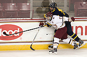 Quinn Smith (BC - 27), Mathieu Tibbet (Merrimack - 22) - The Boston College Eagles defeated the visiting Merrimack College Warriors 2-1 on Wednesday, January 21, 2015, at Kelley Rink in Conte Forum in Chestnut Hill, Massachusetts.