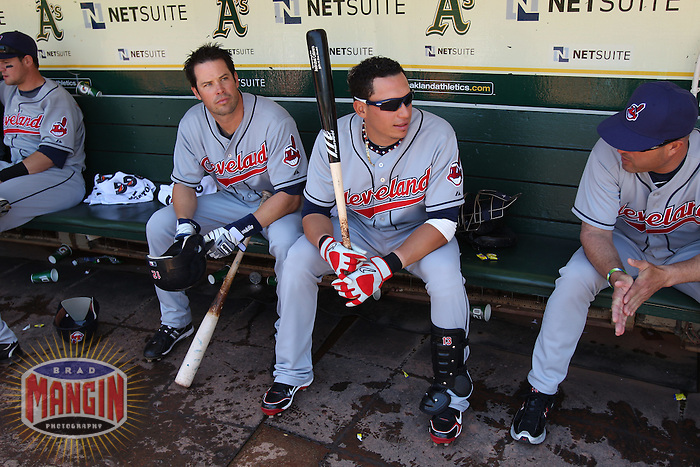 OAKLAND, CA - APRIL 24:  Mark Grudzielanek #12,  Asdrubal Cabrera #13, and manager Manny Acta #11 of the Cleveland Indians get ready in the dugout before the game against the Oakland Athletics at the Oakland-Alameda County Coliseum on April 24, 2010 in Oakland, California. Photo by Brad Mangin