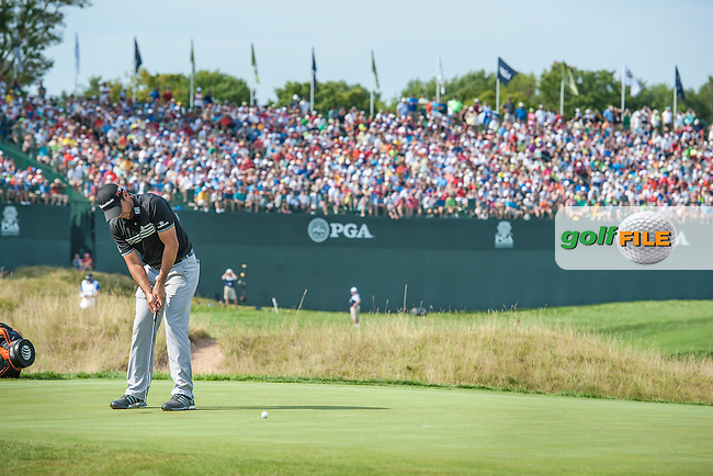 Jason Day (Aust) saves par on the 9th to retain the lead going into the back nine on the final day of the 2015 PGA Championship at Whistling Straits (Photo: Anthony Powter)