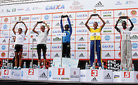SAO PAULO, SP, 04 DE MARCO DE 2012 - MEIA MARATONA INTERNACIONAL DE SAO PAULO -  A atleta queniana Pasalia Chepkorir (C) recebe o trofeu apos vencer a  Meia Maratona Internacional de Sao Paulo, na Praça Charles Muller, na manhã deste domingo (04) na capital paulista.(FOTO: WARLEY LEITE - BRAZIL PHOTO PRESS).
