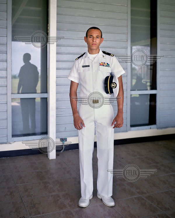 Cadet Oscar Aguilar at the Panamanian Navy School in La Boca. The building once contained the Florida State University of Panama. The first campus was established in 1957 and served as an academic institution where U.S. military and civillians located in the Panama Canal Zone could continue their education. The campus had various locations in Panama City, but was, for many years, located in La Boca (The Mouth). <br /> <br /> The Panama Canal Zone is an area extending 8kms out, in each direction, from the waterway's central line, was a territory controlled by the United States between 1903 and 1979. After a 20 year period of joint administration, the Canal came under the full control of Panama in 1999. The Canal opened to shipping in 1914 and during its tenure was of great strategic importance to the US, enabling it to rapidly move its naval fleet between the Atlantic and Pacific Oceans. However, its economic value came not directly from shipping fees but from the stimulus to trade that the waterway created. One hundred years after it opened in 2014 it is due to have its locks upgraded to cater for the super sized container ships of the 21st Century.  <br /> During the era of American administration thousands of US citizens populated the Canal Zone, living and working under US law in towns built to American standards. Not all of these people returned north after the canal came under full Panamanian control many stayed on, their identities tied to the region.