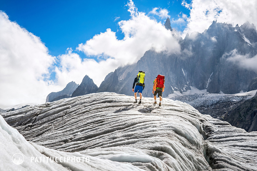 Two hikers on the Mer de Glace, a huge glacier flowing from the Mont Blanc massif in Chamonix, France