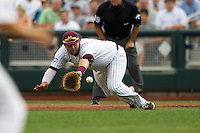 Mississippi State first baseman Wes Rea (35) dives for a ground ball in the first inning against the UCLA Bruins in Game 1 of the 2013 Men's College World Series Final on June 24, 2013 at TD Ameritrade Park in Omaha, Nebraska. The Bruins defeated the Bulldogs 2-1, taking a 1-0 lead in the best of 3 series. (Andrew Woolley/Four Seam Images)