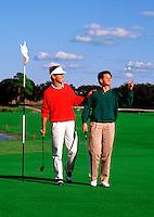 Two men golfing