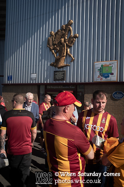 Bradford City 3, Carlisle United 1, 21/09/2019. Valley Parade, EFL League 2. Home supporters standing below a memorial to the 1985 fire at the ground before Bradford City played Carlisle United in a Skybet League 2 fixture at Valley Parade. The home team were looking to bounce back after being relegated during a disastrous 2018-19 season on and off the pitch. Bradford won the match 3-1, watched by a crowd of 14, 217. Photo by Colin McPherson.