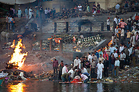 Body bathed in River Ganges and traditional Hindu cremation on funeral pyre at Manikarnika Ghat in Holy City of Varanasi, Benares, India RESERVED USE - NOT FOR DOWNLOAD -  FOR USE CONTACT TIM GRAHAM
